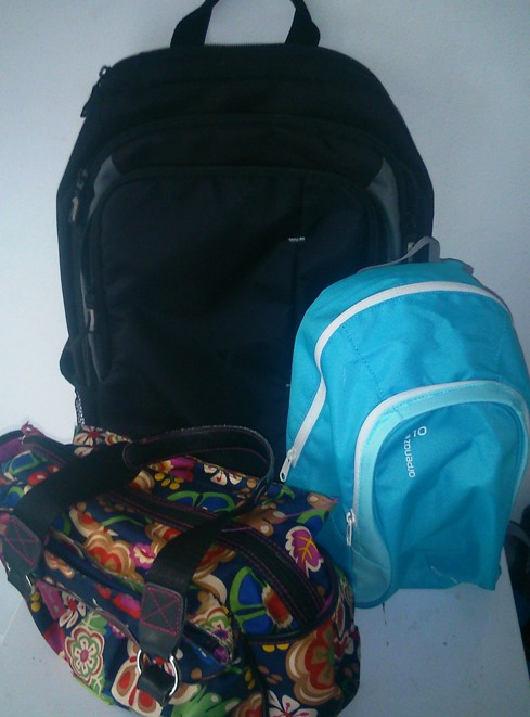 Our luggage for 10 days abroad: a 'laptop backpack', a toddler backpack and a handbag.